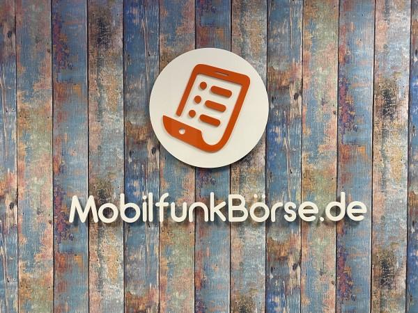 3D Acryl Logo MFB (8mm durchgefärbt) mit Abstandshaltern auf Wand